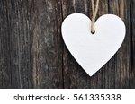 decorative white wooden heart... | Shutterstock . vector #561335338