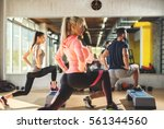sexy athletes doing squats in... | Shutterstock . vector #561344560