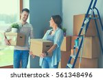 happy young couple unpacking or ... | Shutterstock . vector #561348496