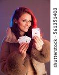 beautiful brunette holding four ... | Shutterstock . vector #561351403