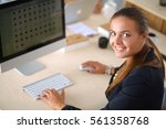 young woman working in office ... | Shutterstock . vector #561358768