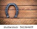Stock photo steel horseshoe on wooden background 561364609