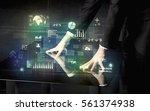 businessman touching... | Shutterstock . vector #561374938