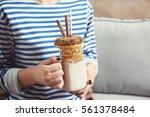 Girl Holding Milkshake With...