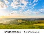sunrise in the rolling rural... | Shutterstock . vector #561403618