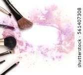 makeup brushes  lip gloss and... | Shutterstock . vector #561407308