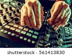 dj playing music at mixer... | Shutterstock . vector #561413830
