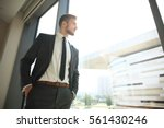 portrait of a businessman... | Shutterstock . vector #561430246