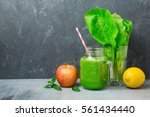 green smoothie with apple ... | Shutterstock . vector #561434440