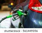 car refueling on a petrol... | Shutterstock . vector #561449356