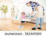 mum teaching daughter cleaning... | Shutterstock . vector #561469300