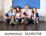 portrait of happy young people... | Shutterstock . vector #561481768