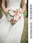 beauty wedding bouquet in bride'... | Shutterstock . vector #561481834