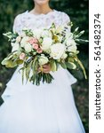 beauty wedding bouquet in bride'... | Shutterstock . vector #561482374