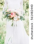 beauty wedding bouquet in bride'... | Shutterstock . vector #561482440