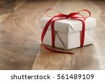 white paper gift box with thin... | Shutterstock . vector #561489109