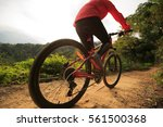 younng woman riding mountain... | Shutterstock . vector #561500368