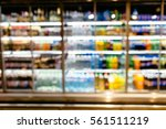 bottles of beverages in fridge. ... | Shutterstock . vector #561511219
