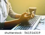 people hands typing on laptop... | Shutterstock . vector #561516319