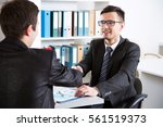 business people shaking hands... | Shutterstock . vector #561519373