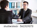 business people shaking hands... | Shutterstock . vector #561519373