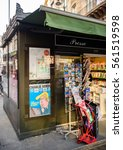 Small photo of PARIS, FRANCE - JAN 21, 2017: French press newsstand featuring headlines with Donald Trump inauguration 45th President of the United States Washington, D.C as a comic satire on Charlie Hebdo cover