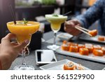couple eating sushi in... | Shutterstock . vector #561529900