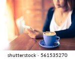 coffee latte with asian woman... | Shutterstock . vector #561535270