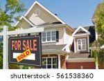 home for sale. sign in front of ... | Shutterstock . vector #561538360