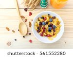 corn flakes and berries on... | Shutterstock . vector #561552280