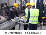 workers in uniform in cnc... | Shutterstock . vector #561556084