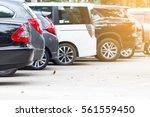 black car parking lot on daytime | Shutterstock . vector #561559450