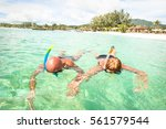senior couple vacationer... | Shutterstock . vector #561579544