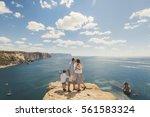 happy family of four walking in ... | Shutterstock . vector #561583324