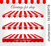 striped awning tent for shop in ... | Shutterstock .eps vector #561583978