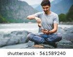 traveler relaxing man make the... | Shutterstock . vector #561589240