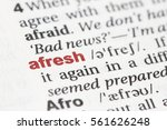 Small photo of Closeup of English dictionary page with word afresh
