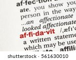 Small photo of Closeup of English dictionary page with word affidavit