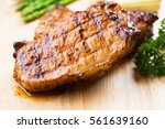 kurobuta pork chop with... | Shutterstock . vector #561639160