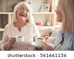 beautiful mature mother and her ... | Shutterstock . vector #561661156