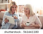 beautiful mature mother and her ... | Shutterstock . vector #561661180