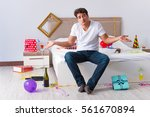 man after heavy christmas... | Shutterstock . vector #561670894
