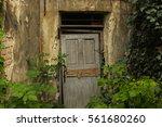 old abandoned door with... | Shutterstock . vector #561680260