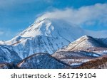 the top of the mountain in the... | Shutterstock . vector #561719104