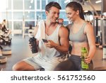 attractive young sports people... | Shutterstock . vector #561752560