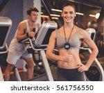 attractive woman trainer is... | Shutterstock . vector #561756550