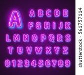 fluorescent neon font on dark... | Shutterstock .eps vector #561757114