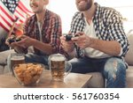 attractive guys are playing...   Shutterstock . vector #561760354
