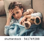 sick little girl covered in... | Shutterstock . vector #561769288