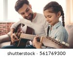 cute little girl and her... | Shutterstock . vector #561769300